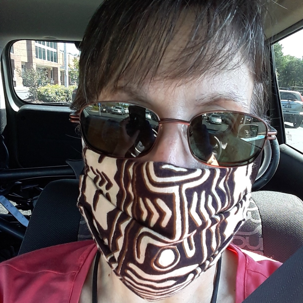 My cloth mask covers my second mask, Parkinson's-generated Resting Bitch Face